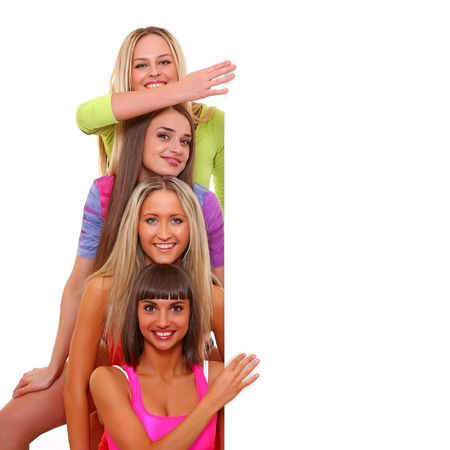 Four young beautiful women hold the white poster with your advertising Standard-Bild