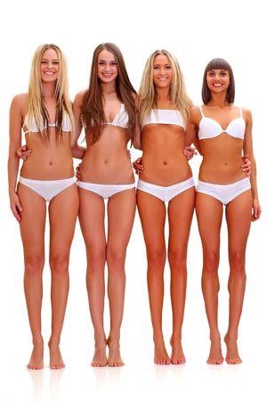 suntanned: Three harmonous suntanned young women in full growth, in white underwear