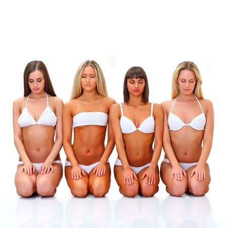 blindly: Four beautiful young women in white underwear sit in a lap blindly Stock Photo