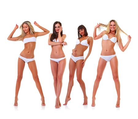 Four harmonous suntanned young women in full growth, in white underwear