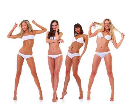 Vier harmonous braungebrannte junge Frauen in vollem Wachstum, in wei�e Unterw�sche