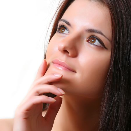 Young beautiful woman close up, pensively looks aside photo