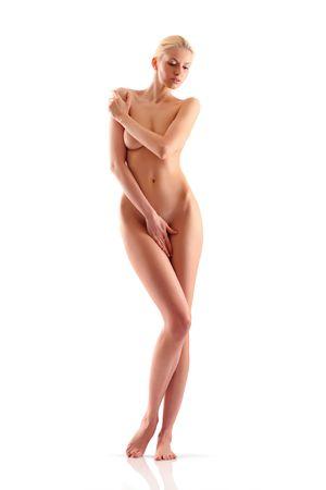 the naked girl: Hermosa mujer desnuda que cubre plantea la propia mano Foto de archivo