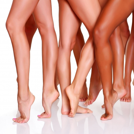 pedicure: Beautiful female slim feet of group of girls