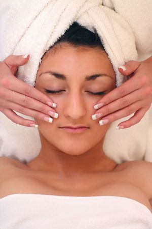 french manicure sexy woman: An attractive young lady getting a facial Stock Photo