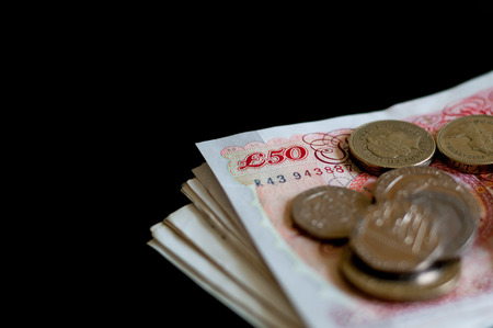 gbp: Pile of money and coins british pounds sterling gbp for business and finance