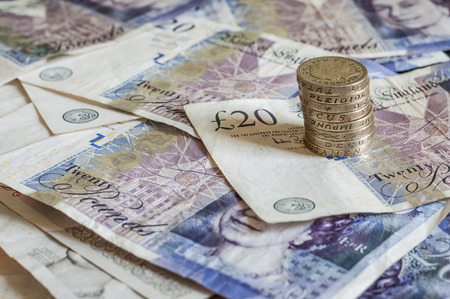 gbp: Pile of money and stacked coins british pounds sterling gbp for business and finance