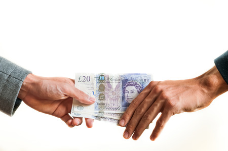 Two businessmen exchanging british money pounds sterling on white background photo