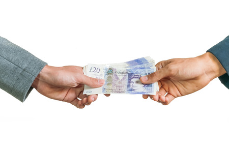 money pounds: Two businessmen exchanging british money pounds sterling on white background