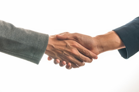 Two businessmen shaking hands against  a white background Stok Fotoğraf