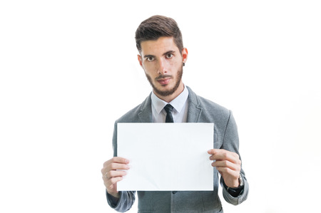 Young business man holding blank card isolated on white