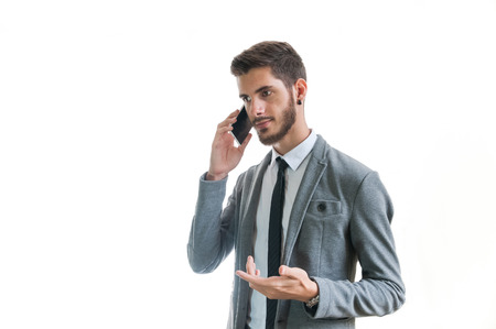 Young successful businessman smiling and talking on the phone isolated on white Stok Fotoğraf