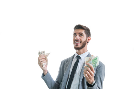 Financial success. Successful and happy business man with money in his hands isolated on white Stok Fotoğraf