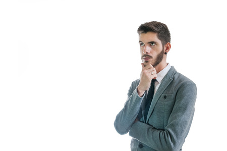 Young business man thinking of an idea and looking confused isolated on white