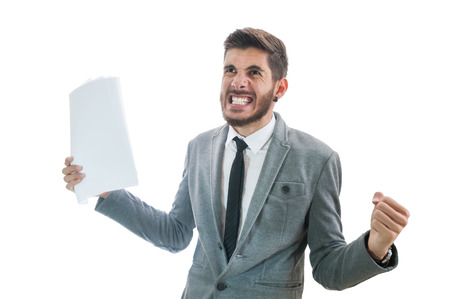Business man holding papers getting very angry and raging