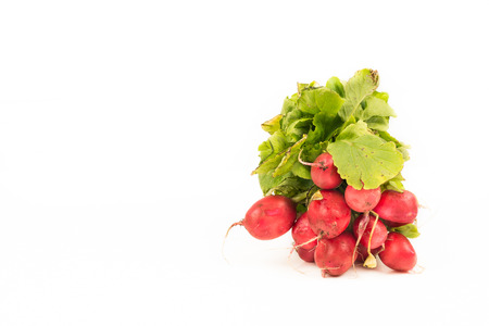 Bunch of radishes isolated on a white background with copy space for text. Organic vegetables for a healthy nutrition and lifestyle Stok Fotoğraf