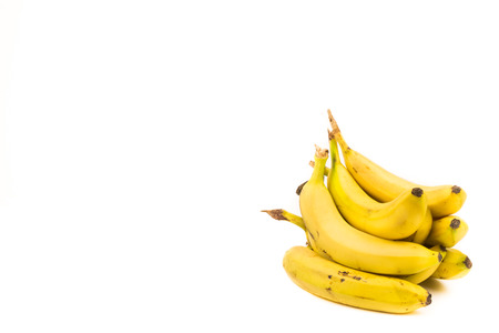 Bunch of ripe bananas isolated on a white background with copy space for text. Organic fruits for a healthy diet and lifestyle