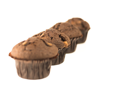 Homemade fresh chocolate muffins isolated on a white background with copy space for text. Organic dessert for a healthy nutrition and lifestyle Stok Fotoğraf