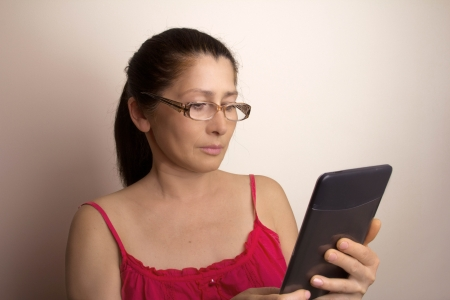 woman showing tablet computer photo