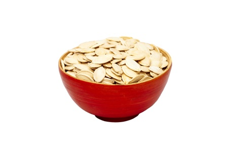 red bowl with pumpkin seeds