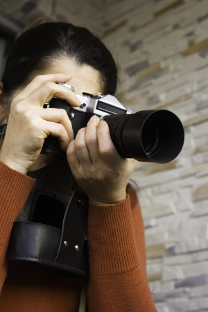 Woman with movie camera on  background Stock Photo