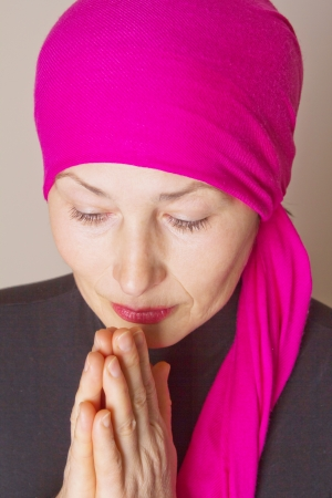 Middle aged woman praying