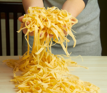 Noodles preparation from dough in home cuisine