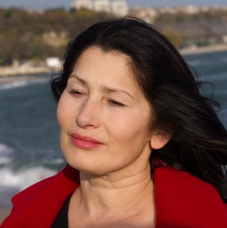 Portrait of the woman enjoying an autumn sunlight