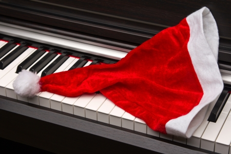 Piano key with santa hat on a white background. photo
