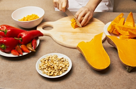 Woman cutting pumpkin