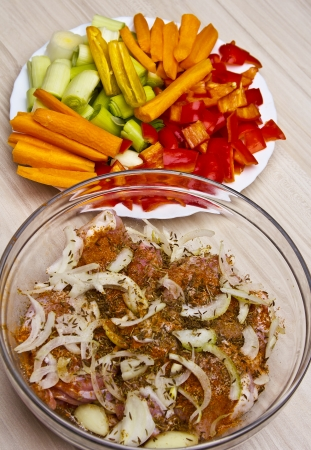 Preparation fried chicken fillets with vegetables photo