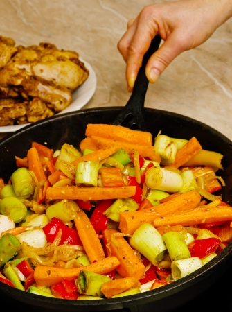 Preparation fried chicken fillets with vegetables Stock Photo