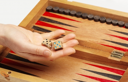 Wooden handmade backgammon board and two dices   Stock Photo