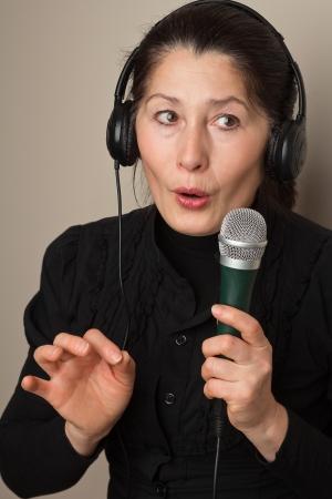 Asian woman listening to music on headphones