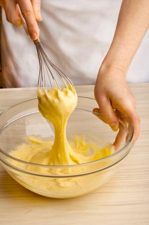 Woman kneading dough Stock Photo