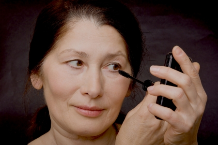 Portrait of the woman doing makeup Stock Photo