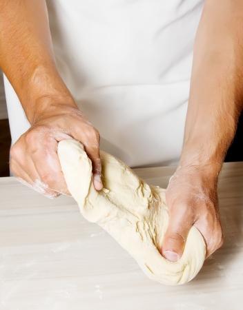 Hands kneading a dough photo