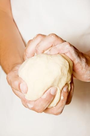 Hands kneading a dough
