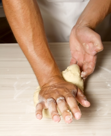 Hands kneading a dough photo