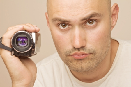 Young man wearing a picture using a camera photo