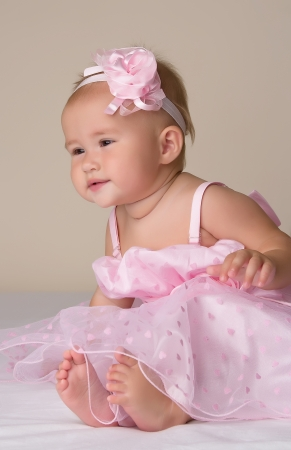 Little baby girl in pink dress  Stock Photo