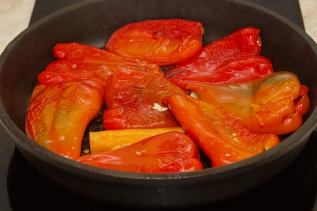 Roasted red bell peppers in a round pan