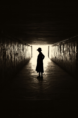 Silhouette of woman in a tunnel  photo