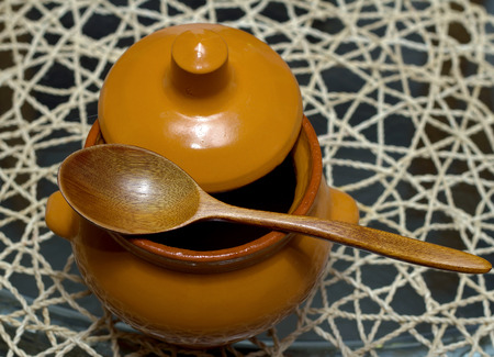 Ceramic pot with a wooden spoon Stock Photo