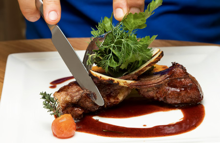 roast lamb: Roasted lamb chops with vegetables Stock Photo