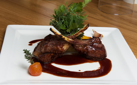 Roasted lamb chops with vegetables Stock Photo