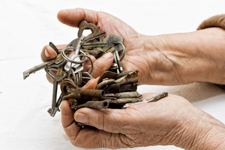 Bunch of old keys in hands  photo