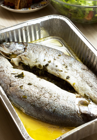 Cooking trout in foil photo