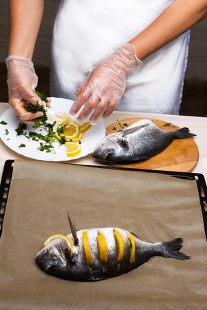 gilthead: Prepare fish sea bream fish with lemon, parsley,garlic