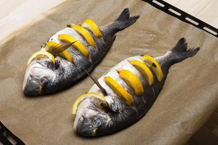 gilthead: Cooked fish sea bream fish with lemon, parsley,garlic